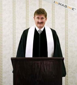 What I might look like with clerical robes, brown hair, no glasses, and a phat mustache